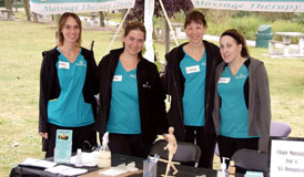 Tracey Beaugrand, Carrie Deslippe, Linda Brandie and Erin Flood perform chair massage at the 2010 Winner's Walk of Hope for Ovarian Cancer