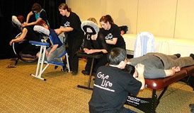 Linda Brandie, Carrie Deslippe, Erin Flood and Clem Leung donate chair massage to the participants in the 2010 Dancing with the Local Stars fundraiser