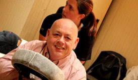 Mike Foster, a 2011 DWLS judge, enjoys a chair massage.